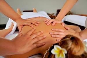 Lady Having 4 Hands Massage Treatment
